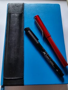 Notebook and pens (with optional penholder)
