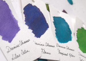 Swatches of four Diamine Shimmertastic inks